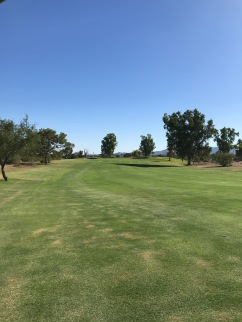 The approach to the par 5, 1st, where a kicker slope short left and water right guard the green complex
